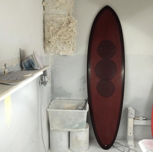 Brown polished surfboard inside the sanding bay