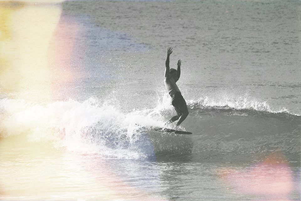 toes on the surfboard nose